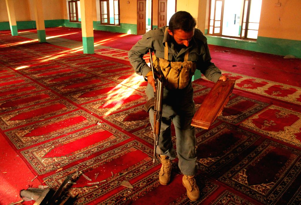 Nangarhar (Afghanistan): An Afghan soldier inspects a mosque following a blast inside a mosque in Nangarhar province in eastern of Afghanistan, Nov. 28, 2014. A bomb exploded inside a mosque in ...