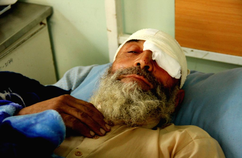 Nangarhar (Afghanistan): An Afghan wounded man receives treatment at a hospital following a blast inside a mosque in Nangarhar province in eastern of Afghanistan, Nov. 28, 2014. A bomb exploded ...
