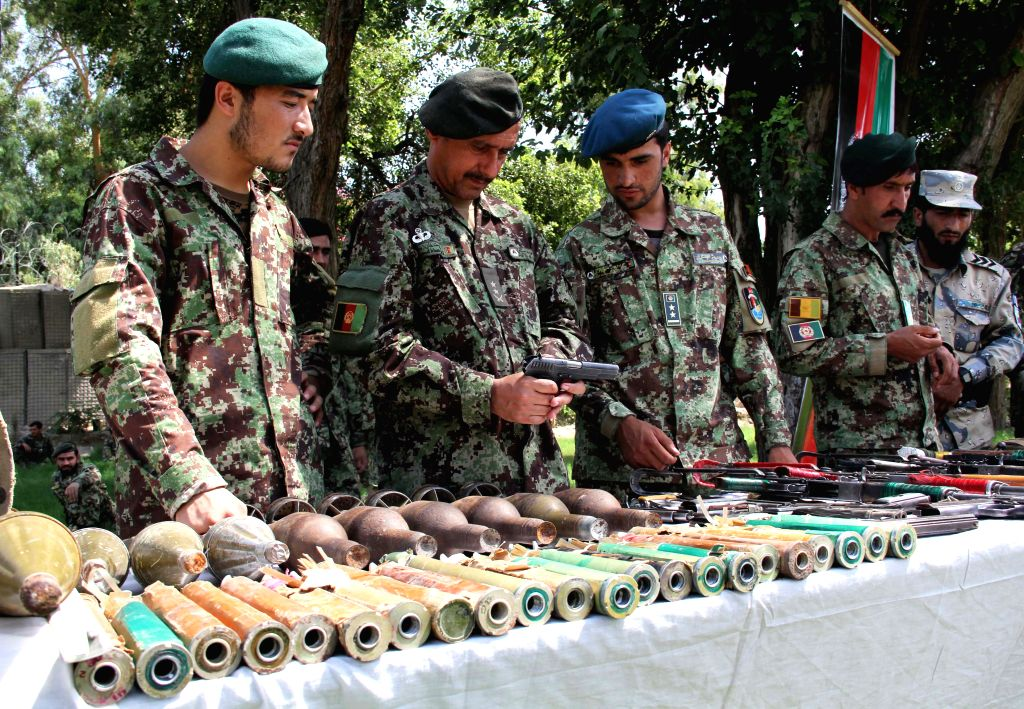 Afghan security forces display ammunition and weapons captured from Taliban militants and armed groups in an operation in east Afghanistan's Nangarhar province, ..
