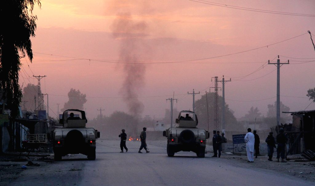 Afghan soldiers inspect the site of an attack in Nangarhar province in eastern Afghanistan on Aug. 30, 2014. Casualties were feared as a suicide car bomb ...