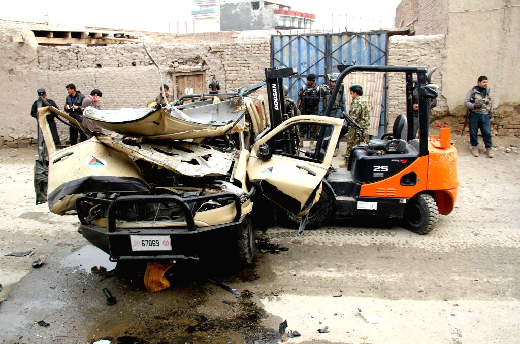 Afghan security forces transfer a destroyed military vehicle following a blast  in east Afghanistan on Dec. 21, 2014. Earlier on Sunday, one soldier and a ...