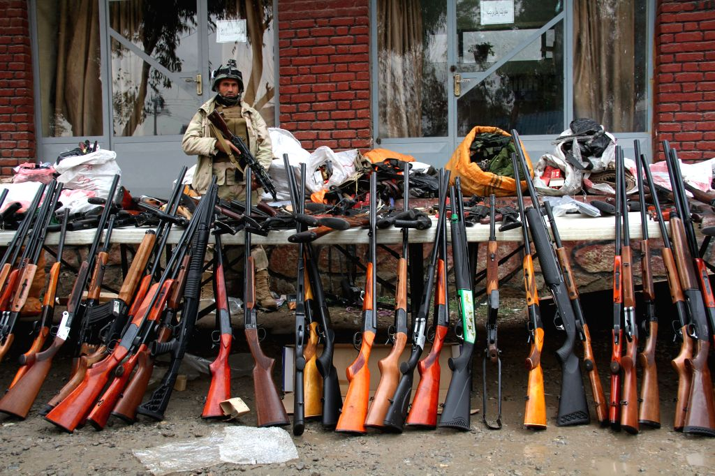 Weapons are displayed after being seized from irresponsible armed group during an operation by Afghan police in Nangarhar province, eastern Afghanistan on Jan. ...