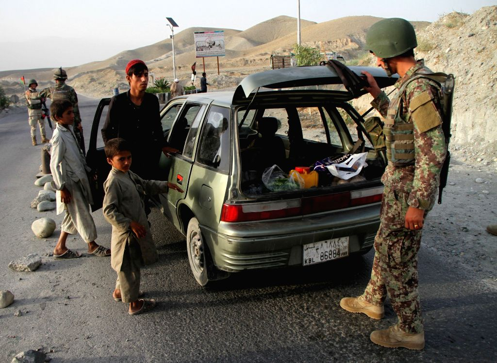 NANGARHAR, June 20, 2017 - A soldier checks a vehicle during a military operation in Nangarhar Province, Afghanistan, June 19, 2017. Afghan security forces conducted a military operation to find two ...
