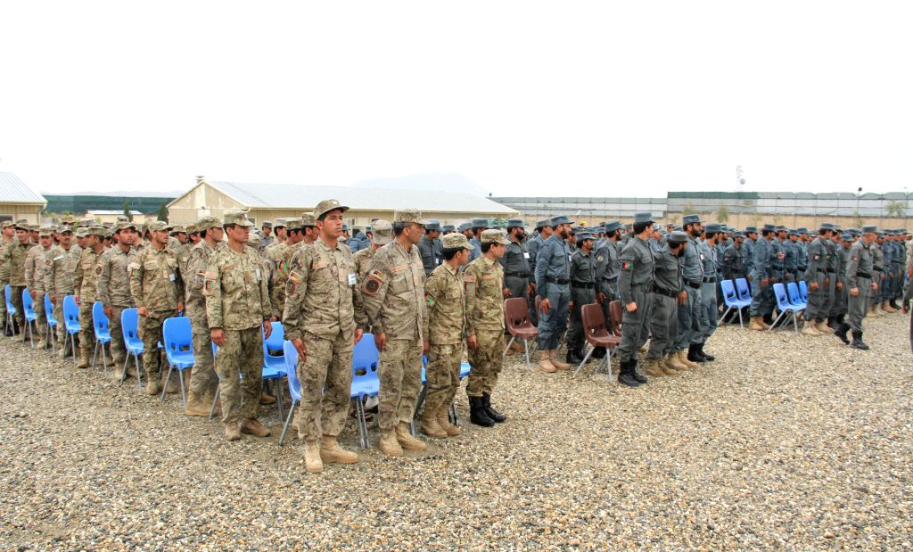 Afghan new policemen attend their graduation ceremony at a police training center in Nangarhar province, eastern Afghanistan, March 16, 2015. A total of 175 new ...
