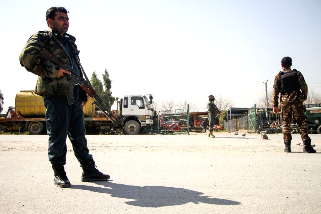 NANGARHAR, March 6, 2019 - Afghan security force members stand guard near the site of an attack in Nangarhar province, Afghanistan, March 6, 2019. A total of 21 people including five attackers were ...