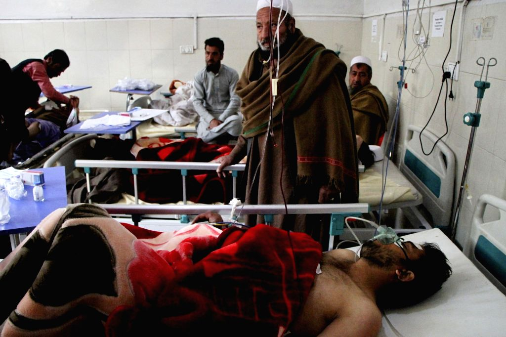 NANGARHAR, March 6, 2019 (Xinhua) -- Injured men receive medical treatment at a local hospital after an attack in Nangarhar province, Afghanistan, March 6, 2019. A total of 21 people including five attackers were killed and nine others injured as a b