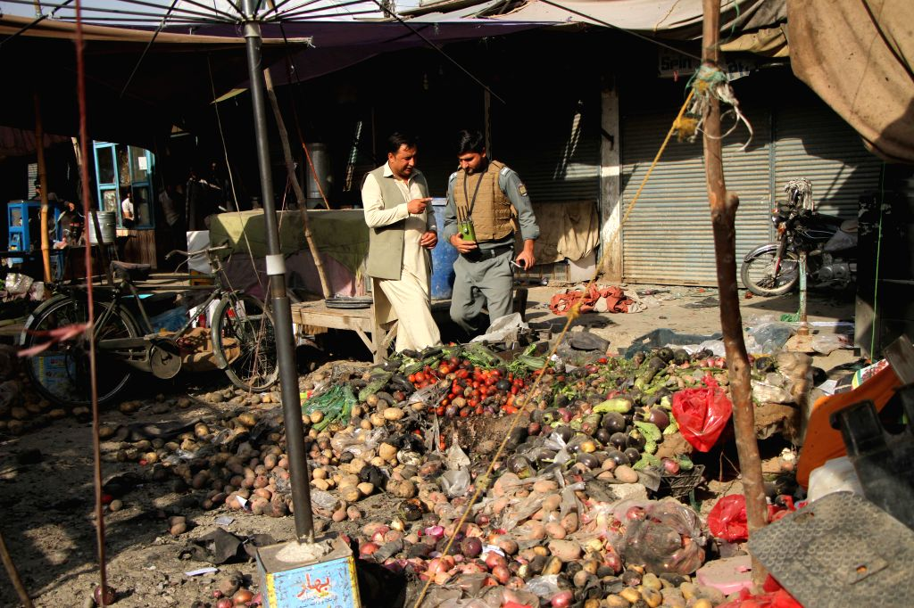 NANGARHAR, Sept. 13, 2017 - Afghan security officers inspect the site of a blast in Nangarhar province, Afghanistan, Sept. 13, 2017.  Six civilians were injured as a blast rocked Jalalabad city, the ...