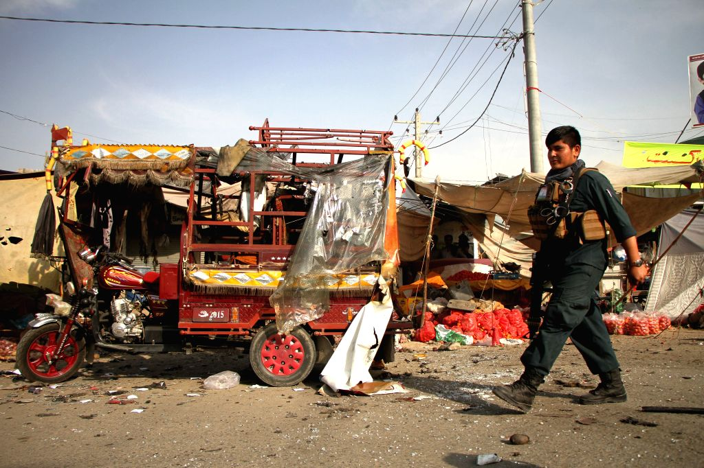 NANGARHAR, Sept. 13, 2017 - An Afghan security officer inspects the site of a blast in Nangarhar province, Afghanistan, Sept. 13, 2017.  Six civilians were injured as a blast rocked Jalalabad city, ...
