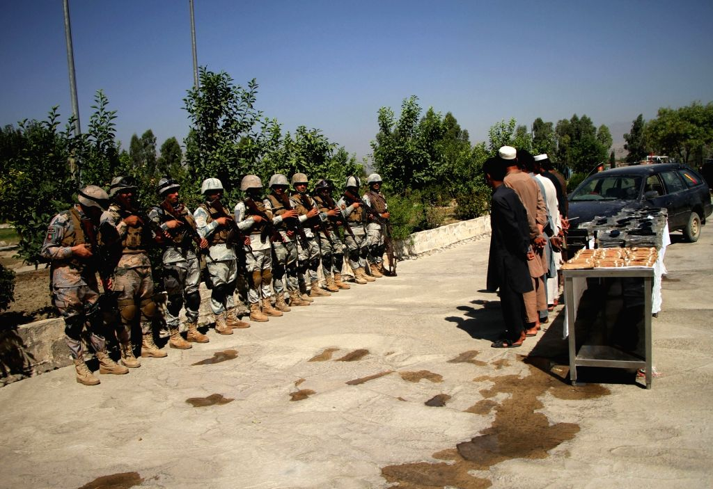 NANGARHAR, Sept. 17, 2018 - Suspected weapon smugglers stand handcuffed after being arrested in Jalalabad city, Nangarhar province, Afghanistan, Sept. 17, 2018. Police have arrested seven suspected ...