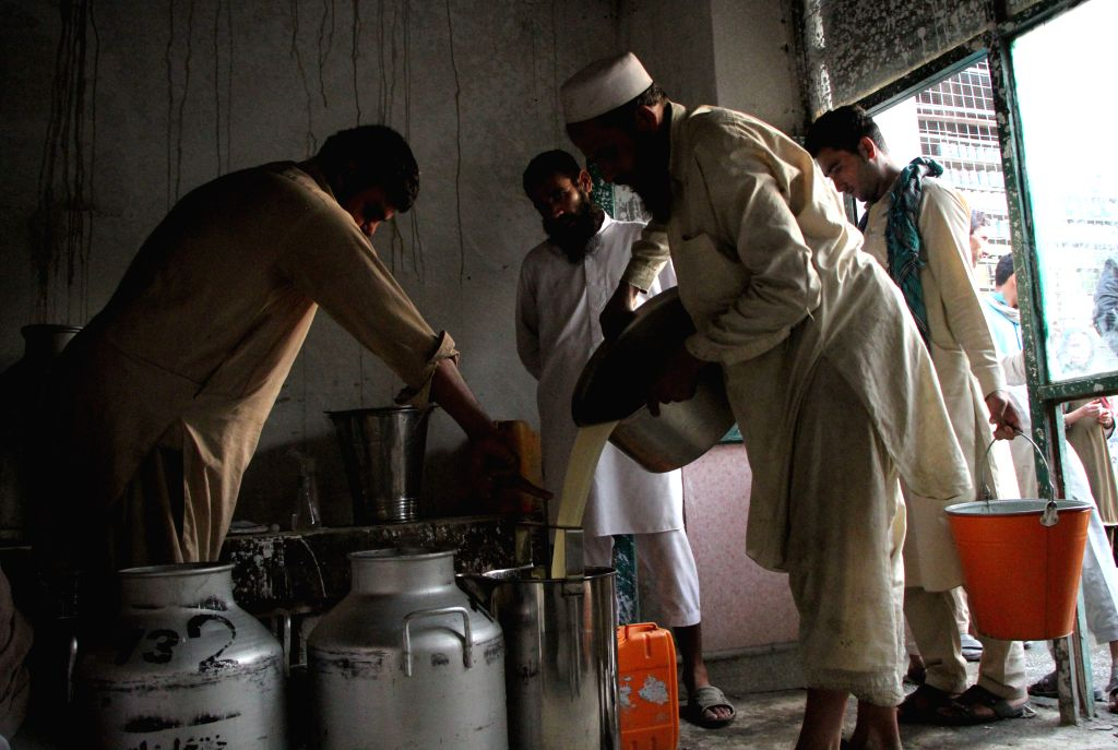 NANGARHAR, Sept. 19, 2016 - Afghan men work at a milk factory in Nangarhar province, Afghanistan, Sept. 19, 2016. The agricultural sector, the backbone of the national economy in the land-locked ...