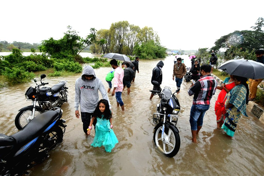 Nanjanagudu : Rain waters inundate Mysuru-Nanjangud Highway (NH-766) in Karnataka's Nanjanagudu on Aug 9, 2019.