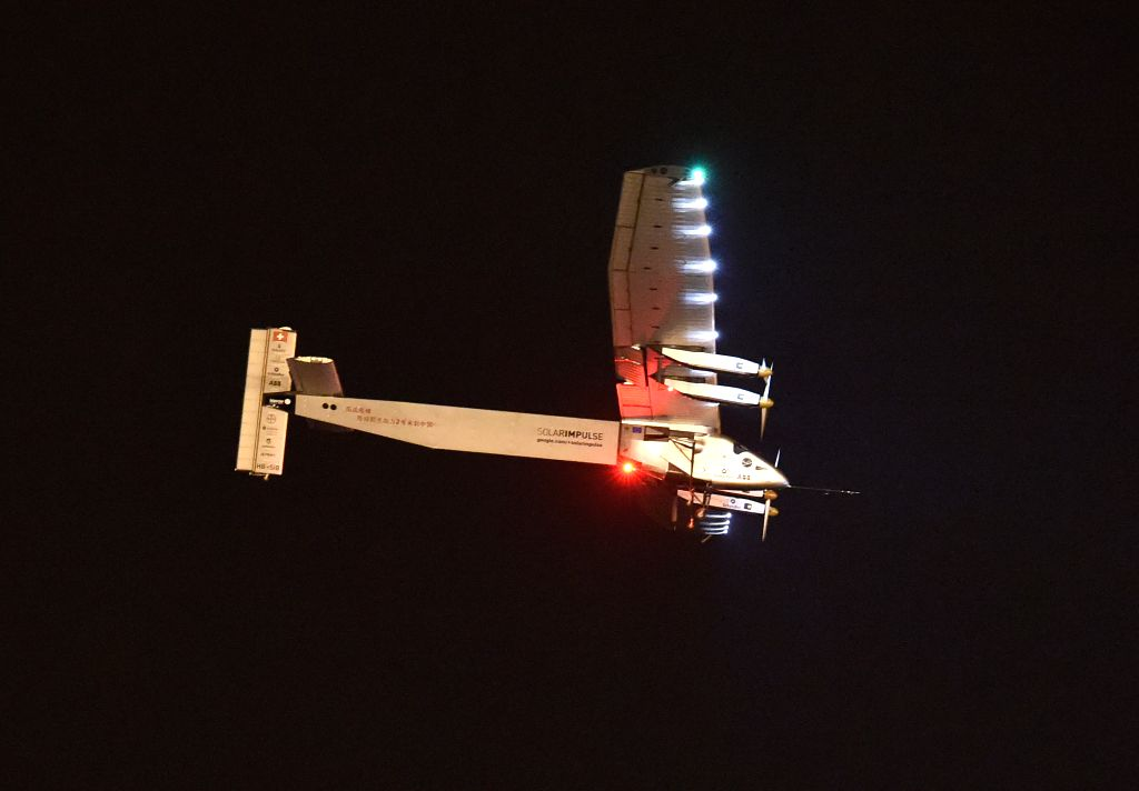 Swiss-made solar-powered plane Solar Impluse 2 prepares to land on Nanjing Lukou International Airport in Nanjing, capital of east China's Jiangsu Province, April ...