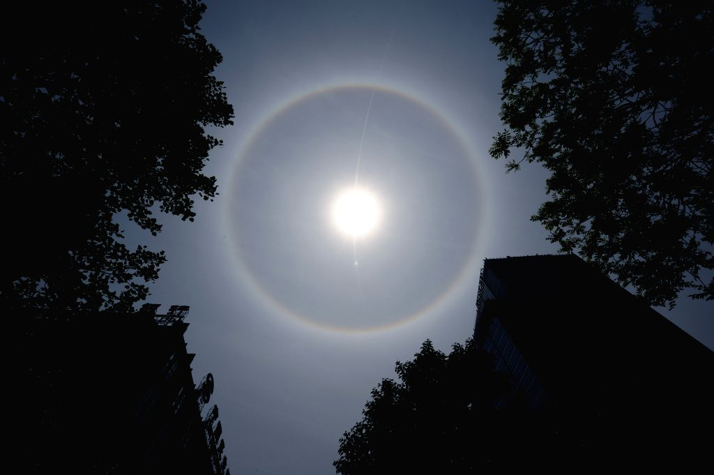 A solar halo occurs over the sky in Nanjing, capital of east China's Jiangsu Province, April 23, 2014.
