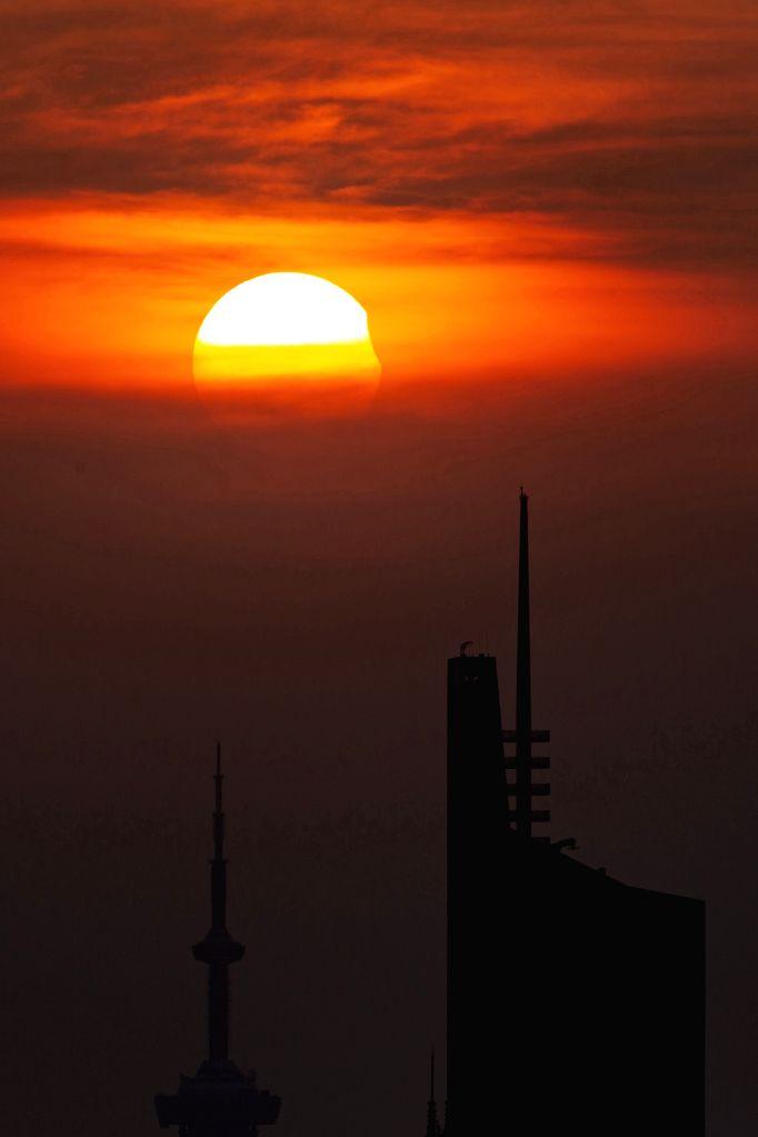 NANJING, Aug. 11, 2018 - Photo taken on Aug. 11, 2018 shows the sun going through a partial solar eclipse in Nanjing, capital of east China's Jiangsu Province.