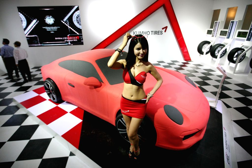 A model presents a car during the 2013 Nanjing Auto Expo in Nanjing, capital of east China's Jiangsu Province, Aug. 16, 2013. The five-day event kicked ...