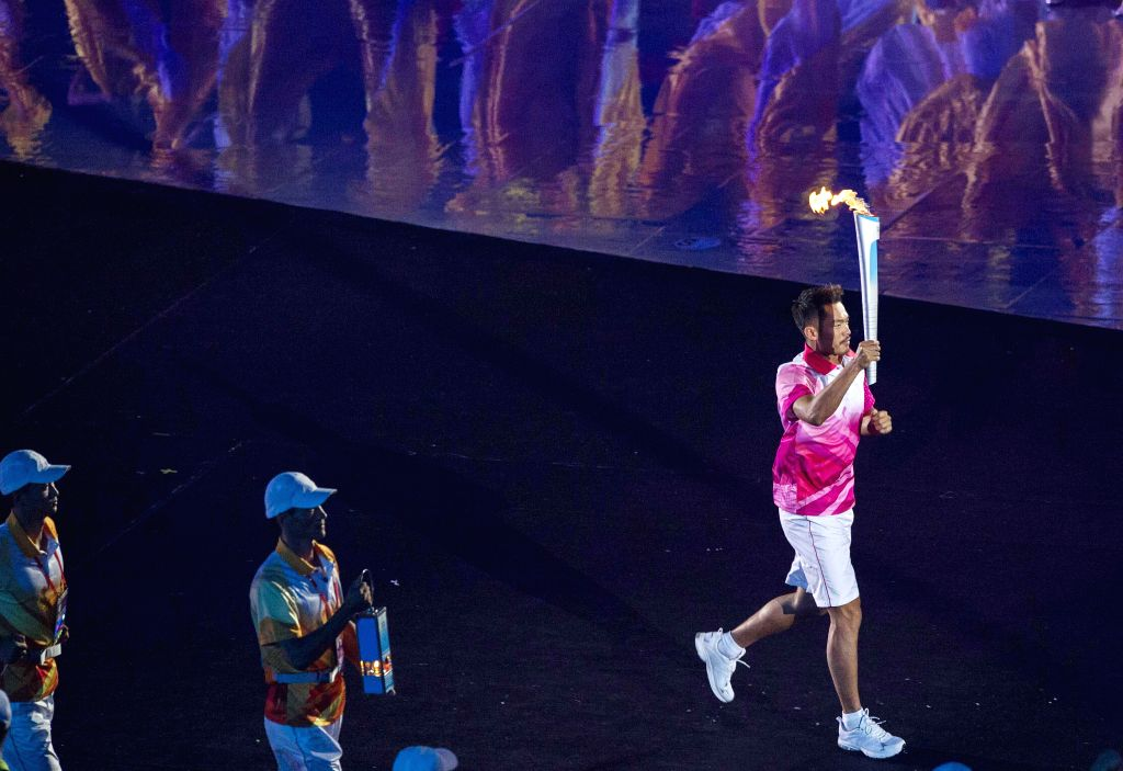 Chinese badminton player Lin Dan runs with torch at the Opening Ceremony of the Nanjing 2014 Youth Olympic Games in Nanjing, capital of east China's Jiangsu ...