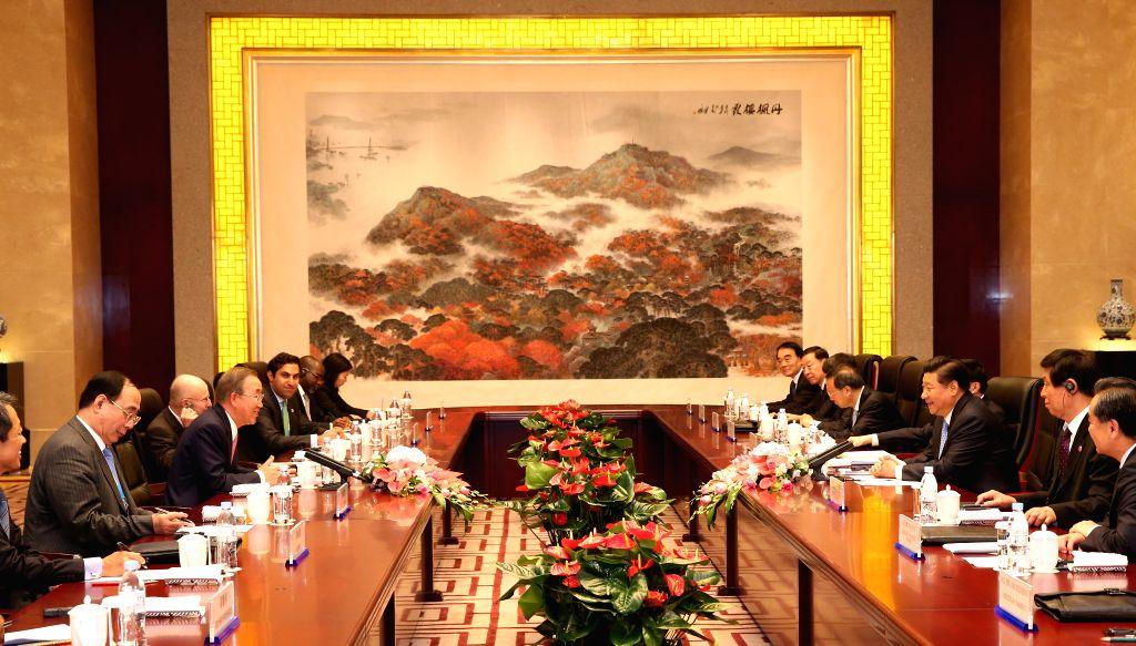 Chinese President Xi Jinping (3rd R) meets with UN Secretary-General Ban Ki-moon (3rd L) in Nanjing, capital of east China's Jiangsu Province, Aug. 16, 2014. ...