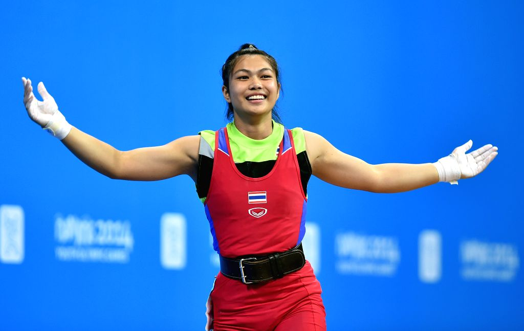 Rattanaphon Pakkaratha of Thailand celebrates the winning after the women's 53kg match of weightlifting event at the Nanjing 2014 Youth Olympic Games in Nanjing, ..