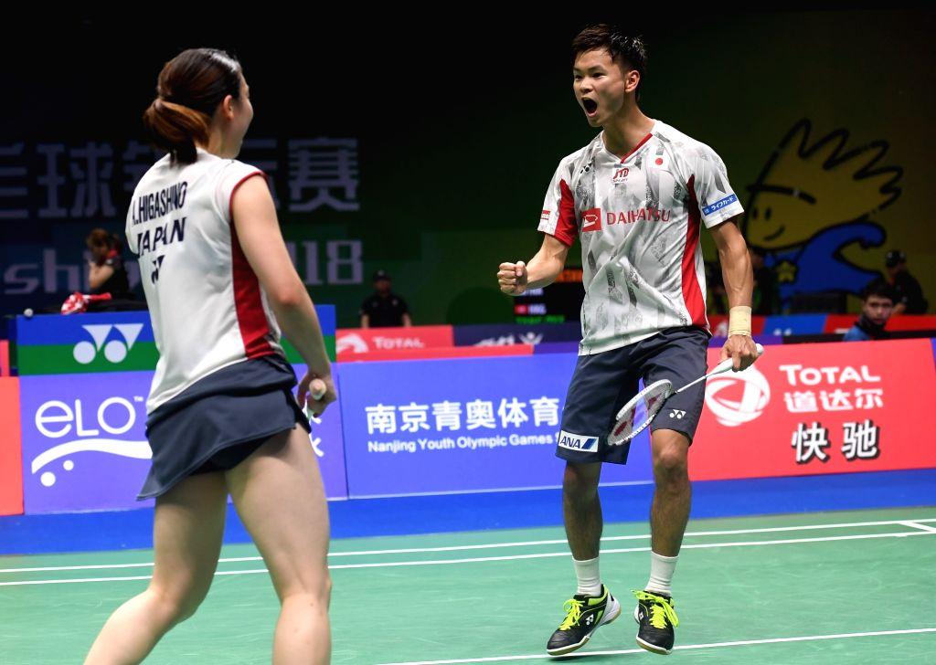 NANJING, Aug. 2, 2018 - Yuta Watanabe (R) and Arisa Higashino of Japan celebrate during the mixed doubles third round match against Wang Yilyu and Huang Dongping of China at the BWF (Badminton World ...