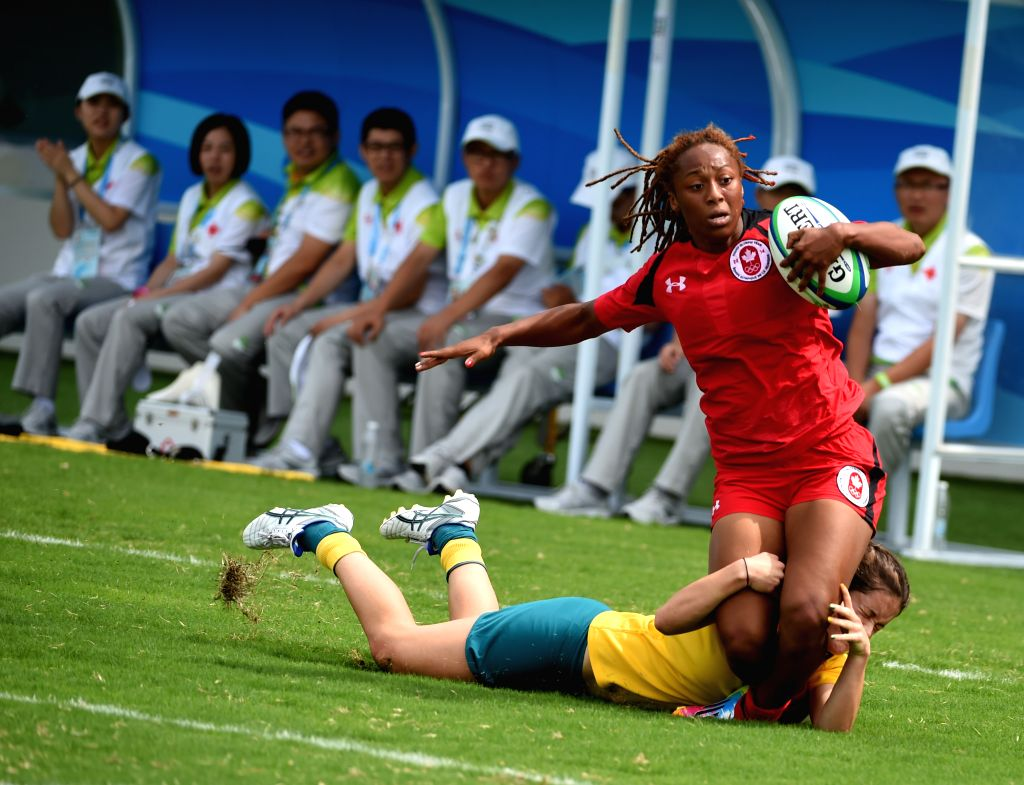 Charity Williams of Canada competes during the women gold medal match of rugby sevens against Australia at Nanjing 2014 Youth Olympic Games in Nanjing, capital of ..