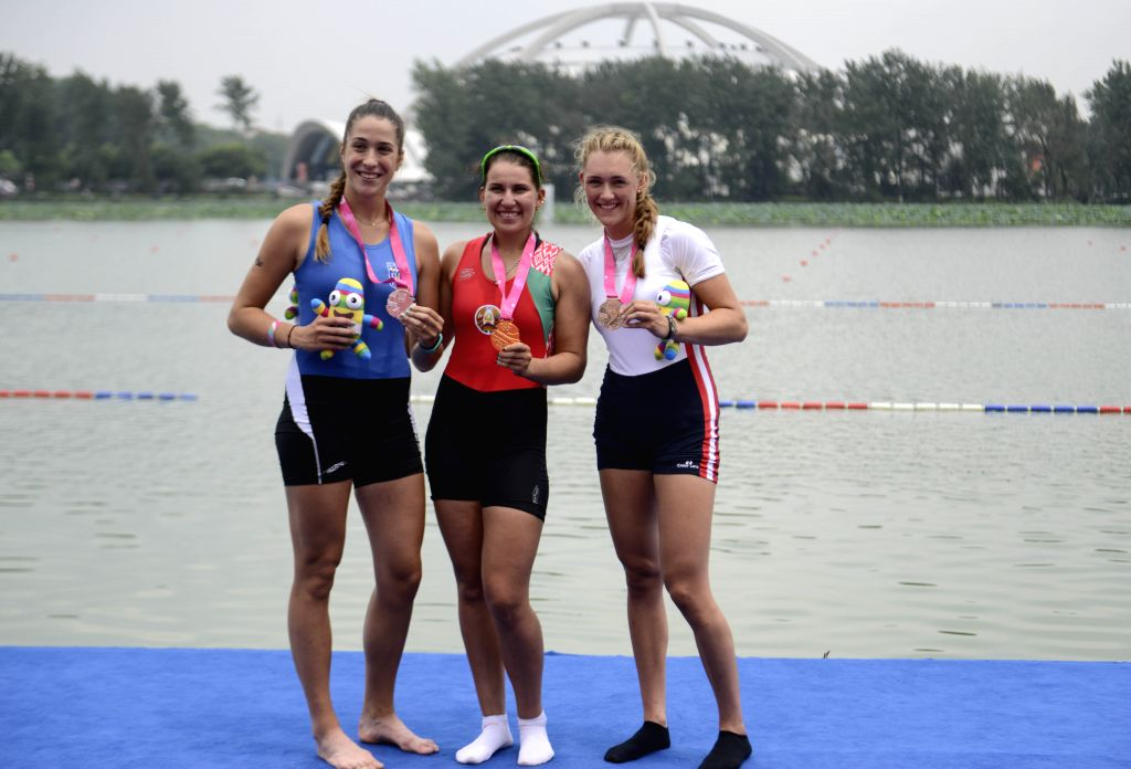 Gold medalist Krystsina Staraselets (C) of Belarus,  silver medalist Athina Maria Angelopoulou (L) of Greece and bronze medalist Camille Juillet (R) of France pose ..