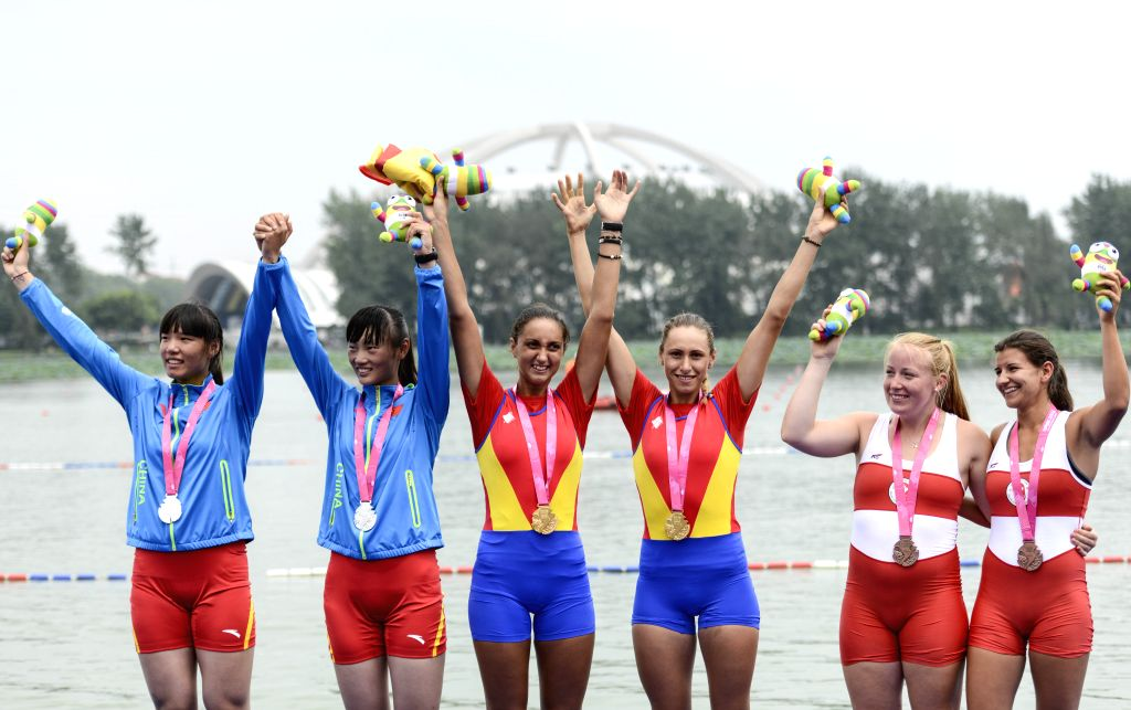 Gold medalists Cristina Georgiana Popescu and Denisa Tilvescu (C) of Romania, silver medalists Luo Yadan and Hanjie (R) of People's Republic of China, bronze ...
