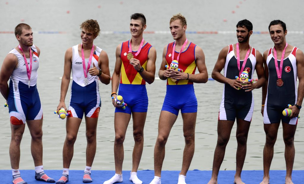 Gold medalists Gheorghe Robert Dedu and Ciprian Tudosa (C) of Romania, silver medalists Miroslav Jech and Lukas Helesic (L) of Czech Republic and bronze medalists ...
