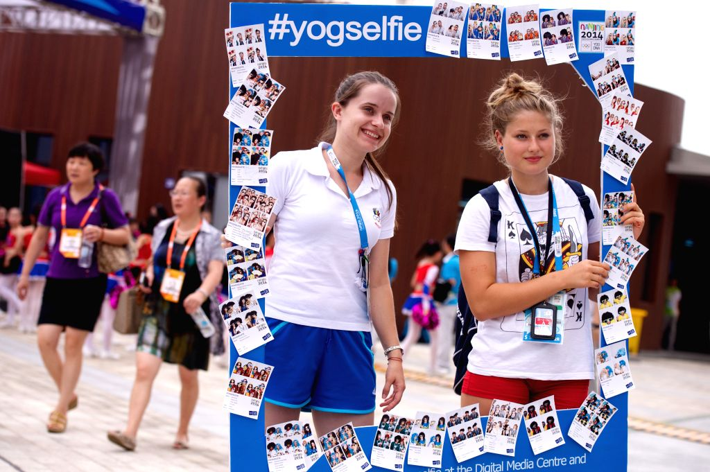 Girls in the athletes village of Nanjing 2014 Youth Olympic Games in Nanjing, capital of east China`s Jiangsu Province, on Aug. 22, 2014.