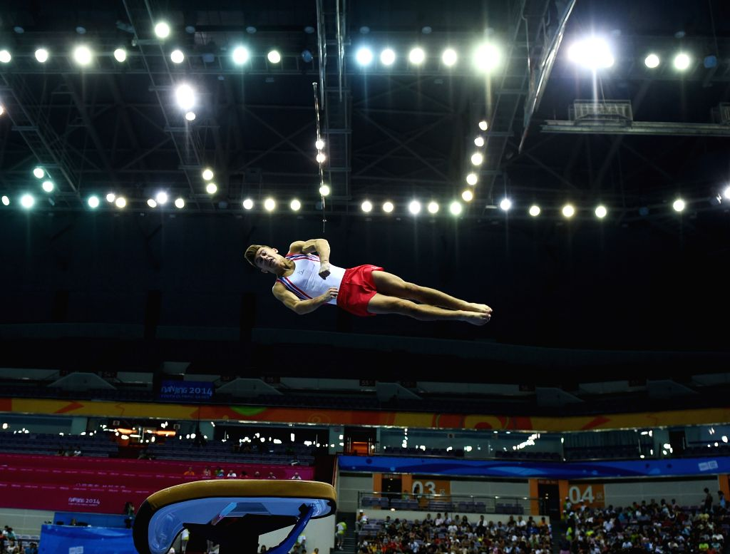Giarnni Regini-Moran of Great British competes during the men's vault event of artistic gymnastic at Nanjing 2014 Youth Olympic Games in Nanjing, east China's ...