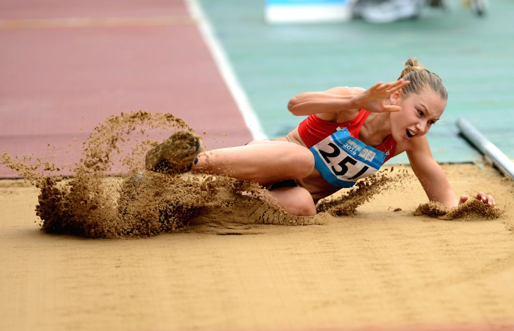 Bronze medalist Ester Bajnok of Hungary competes in the Women?s Triple Jump Final of athletics event at the Nanjing 2014 Youth Olympic Games in Nanjing, capital of
