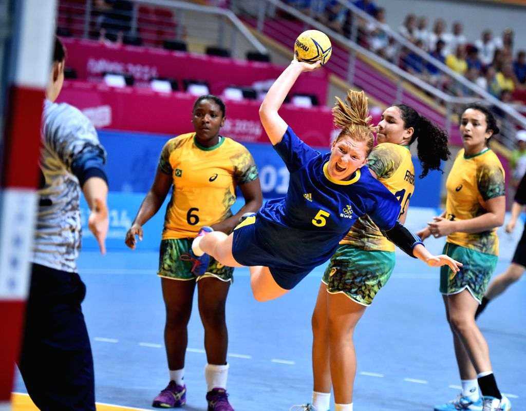 Sofia Hvemfelt (Front)of Sweden shoots during the Women's Bronze Medal Match of handball against Brazil at Nanjing 2014 Youth Olympic Games in Nanjing, east China's