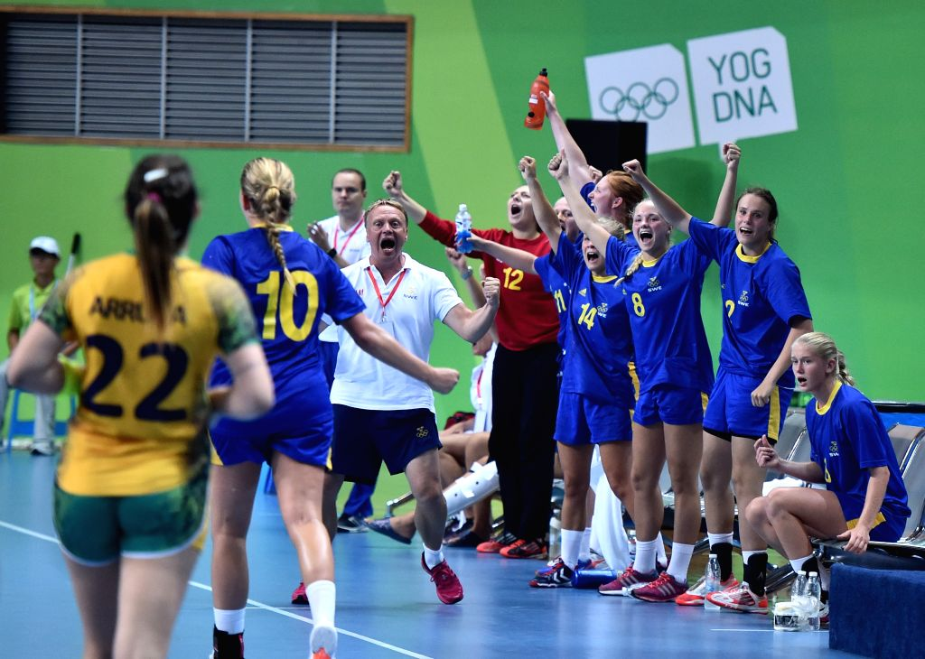 Sweden' players celebrate a point during the Women's Bronze Medal Match of handball against Brazil at Nanjing 2014 Youth Olympic Games in Nanjing, east China's ...