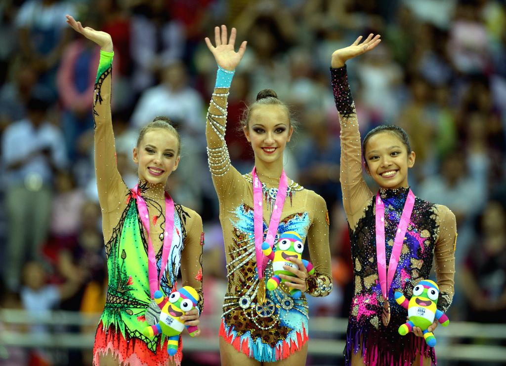 Gold medalist Irina Annenkova (C) of Russian Federation, silver medalist Maryia Trubach (L) of Belarus and bronze medalist Laura Zeng of United States of America ...