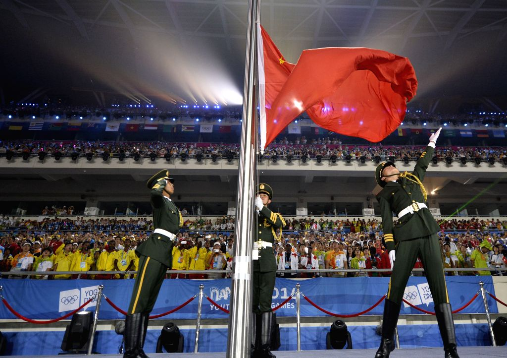 The national flag of People`s Republic of China is raised during the closing ceremony of Nanjing 2014 Youth Olympic Games in Nanjing, capital of east China`s ...
