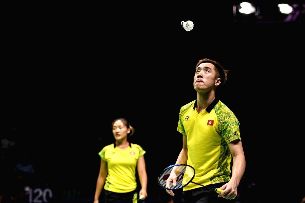 NANJING, Aug. 4, 2018 - Tang Chun Man (Front)/Tse Ying Suet from Hong Kong of China compete during the mixed doubles semifinal match against Wang Yilyu/Huang Dongping of China at the BWF (Badminton ...