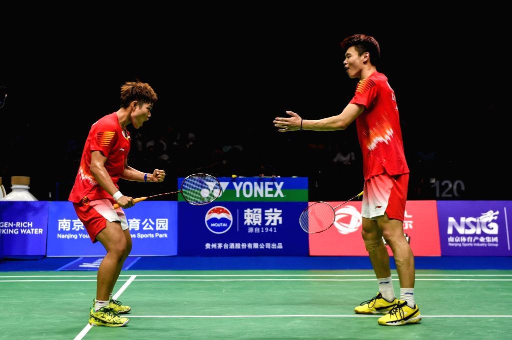 NANJING, Aug. 4, 2018 - Wang Yilyu (R)/Huang Dongping of China celebrate victory after the mixed doubles semifinal match against Tang Chun Man/Tse Ying Suet from Hong Kong of China at the BWF ...
