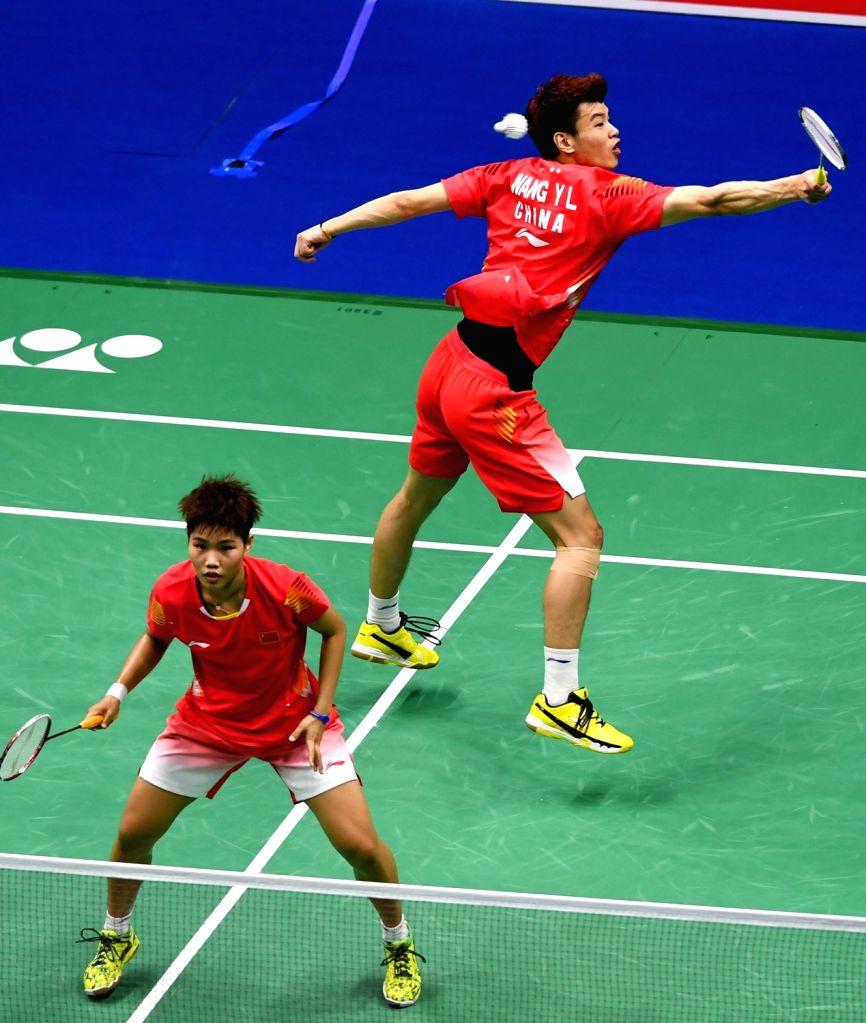 NANJING, Aug. 4, 2018 - Wang Yilyu (R)/Huang Dongping of China compete during the mixed doubles semifinal match against Tang Chun Man/Tse Ying Suet from Hong Kong of China at the BWF (Badminton World ...