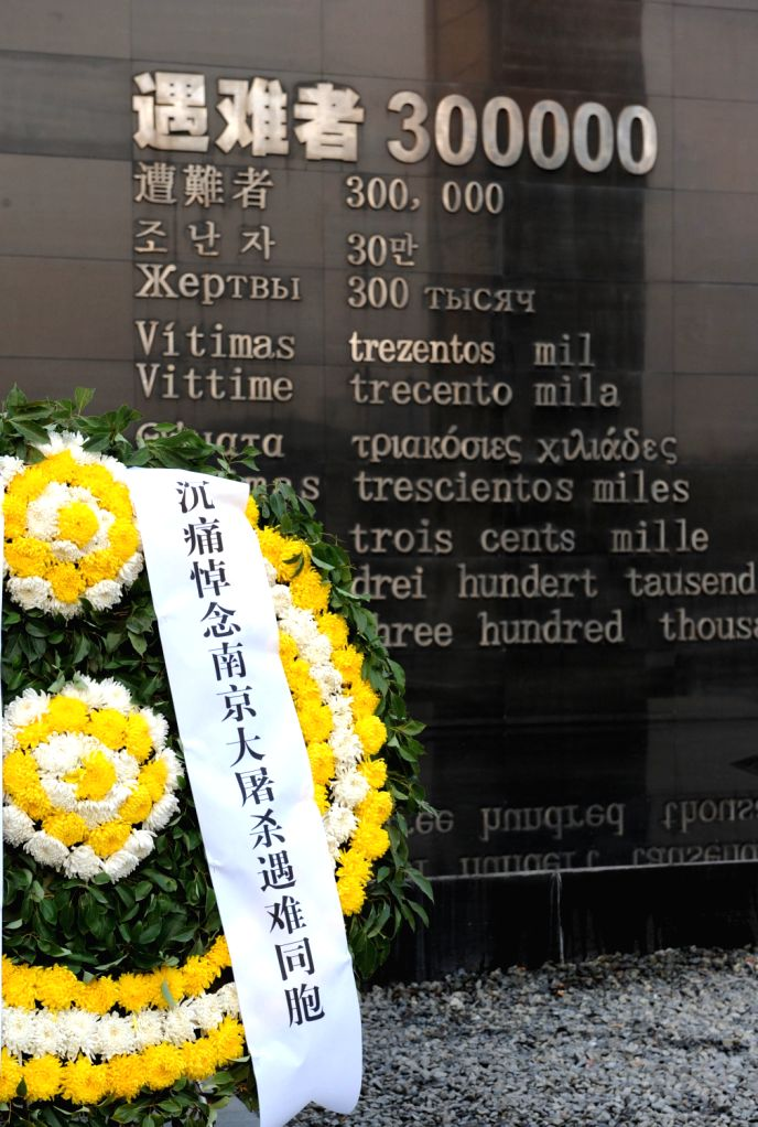 A wreath is laid at a memorial ceremony at the Memorial Hall of the Victims in Nanjing Massacre by Japanese Invaders in Nanjing, capital of east China's ..