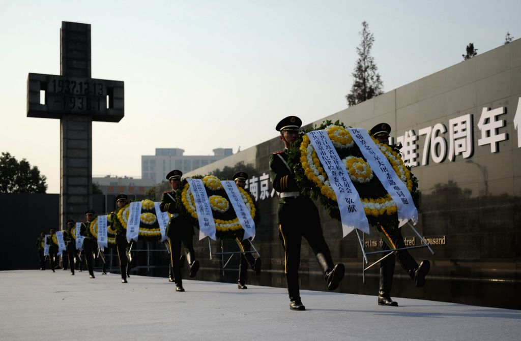 Soldiers present wreaths during a memorial ceremony at the Memorial Hall of the Victims in Nanjing Massacre by Japanese Invaders in Nanjing, capital of east ...