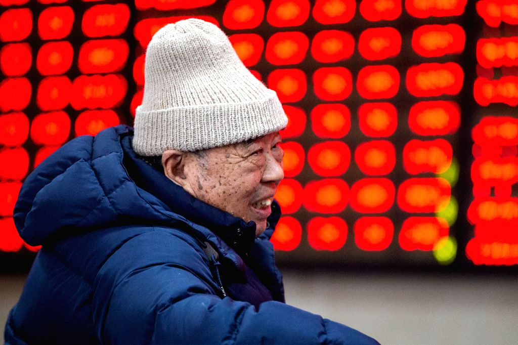 NANJING, Feb. 11, 2019 - An investor is seen at a stock exchange in Nanjing, east China's Jiangsu Province, Feb. 11, 2019, the first trading day of the Year of the Pig. China's major stock indices ...