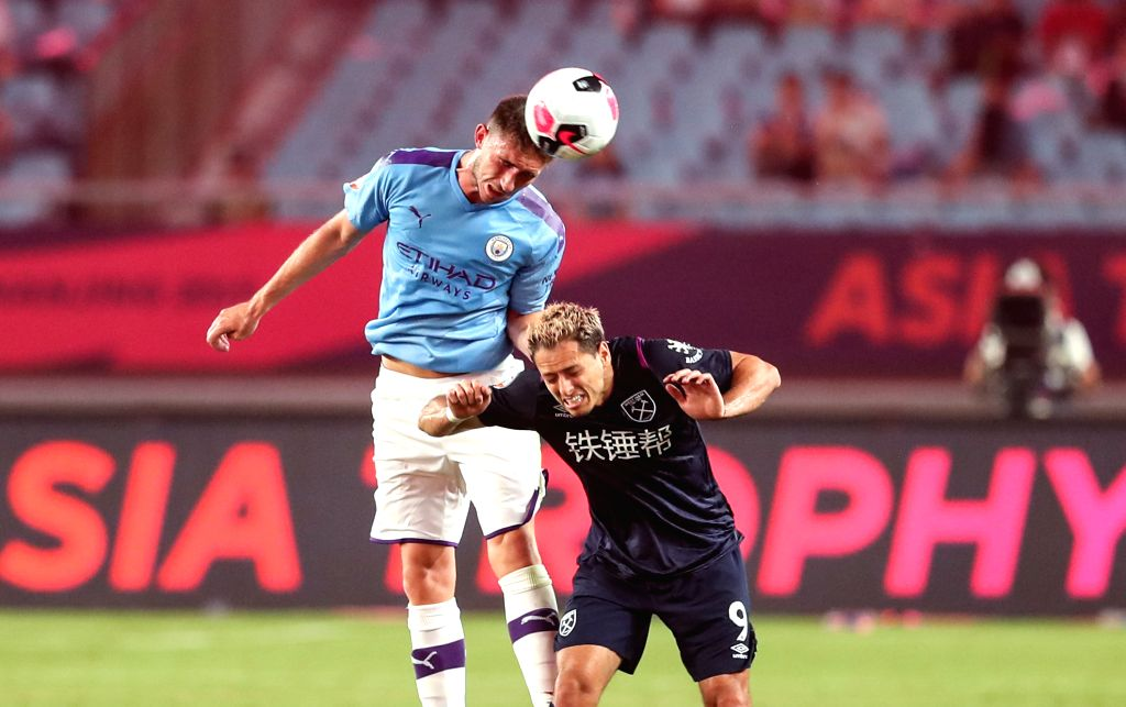 NANJING, July 17, 2019 - Aymeric Laporte (L) of Manchester City competes for a header with Chicharito of West Ham United during a Premier League Asia Trophy match between Manchester City and West Ham ...