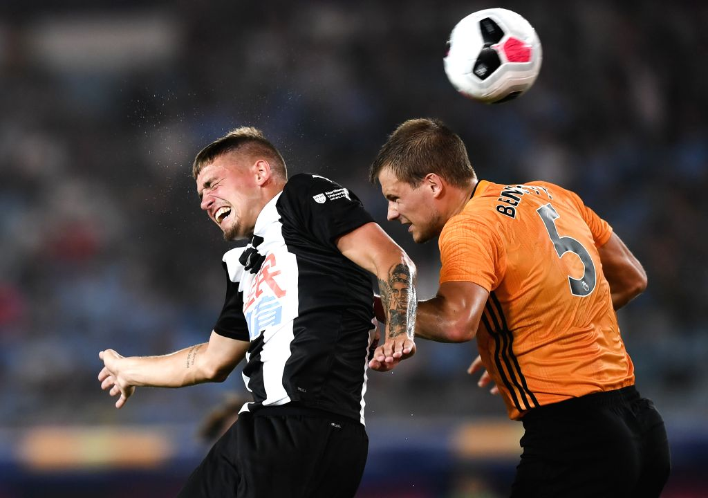 NANJING, July 17, 2019 - Elias Sorensen (L) of Newcastle United and Ryan Bennett of Wolverhampton Wanderers head for the ball during a Premier League Asia Trophy match between Newcastle United and ...