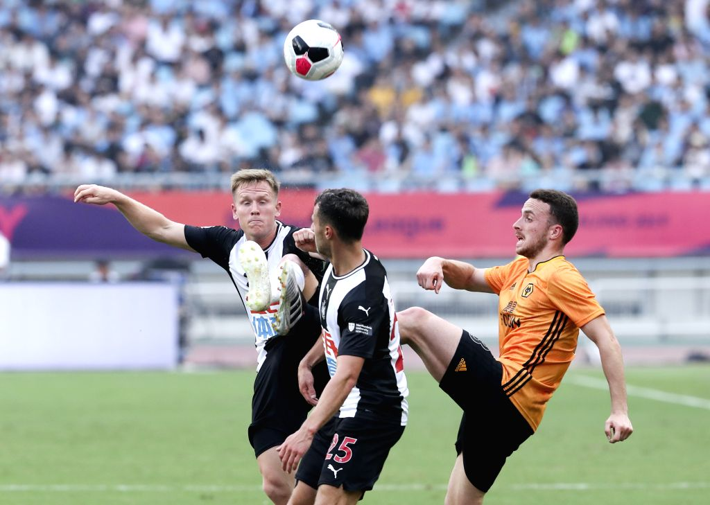 NANJING, July 17, 2019 - Matthew Ritchie (L) of Newcastle United competes during a Premier League Asia Trophy match between Newcastle United and Wolverhampton Wanderers in Nanjing, east China's ...