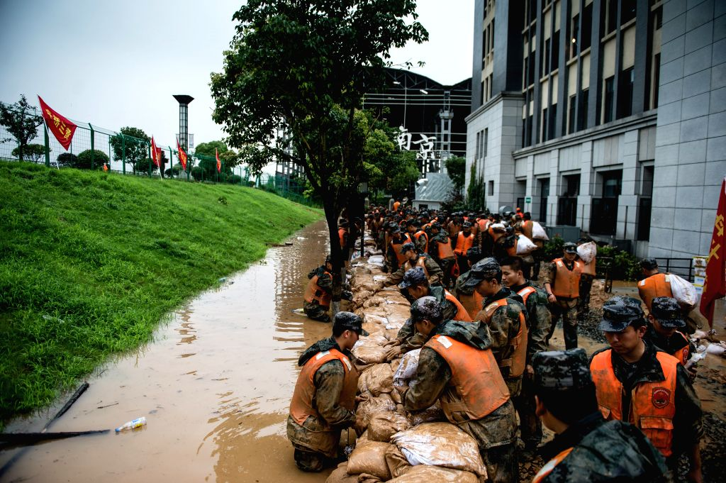 NANJING, July 4, 2016 - Rescuers reinforce a temporary dyke in Shuren Middle School in Nanjing, capital of east China's Jiangsu Province, July 4, 2016. A section of the embankment of Yangtze River ...