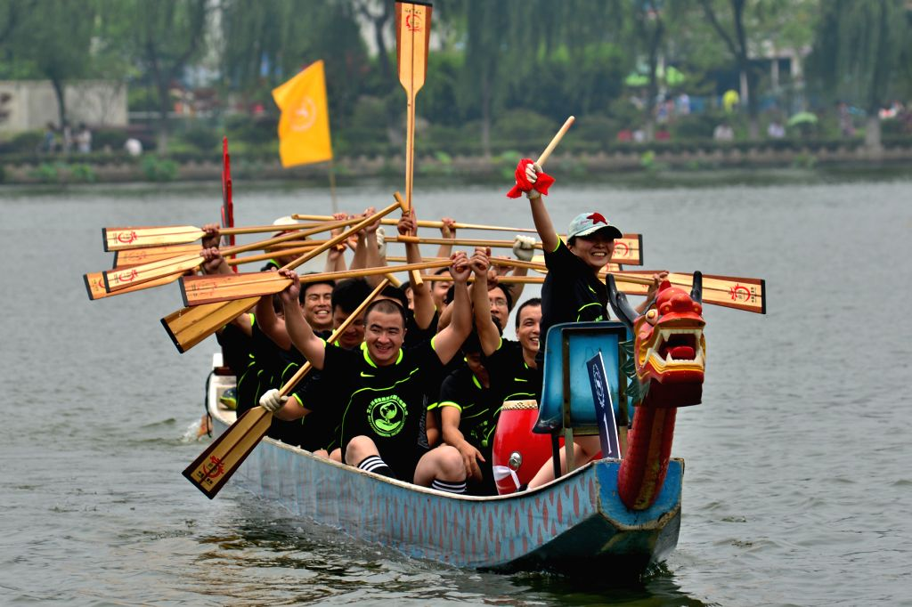 Participants celebrate after winning a dragon boat race held to mark the Dragon Boat Festival, in Nanjing, capital of east China's Jiangsu Province, June 20, 2015. ...