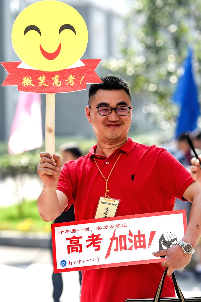NANJING, June 7, 2018 - A teacher encourages examinees at an exam venue in Nanjing, capital of east China's Jiangsu Province, June 7, 2018. About 9.75 million students have registered for the ...