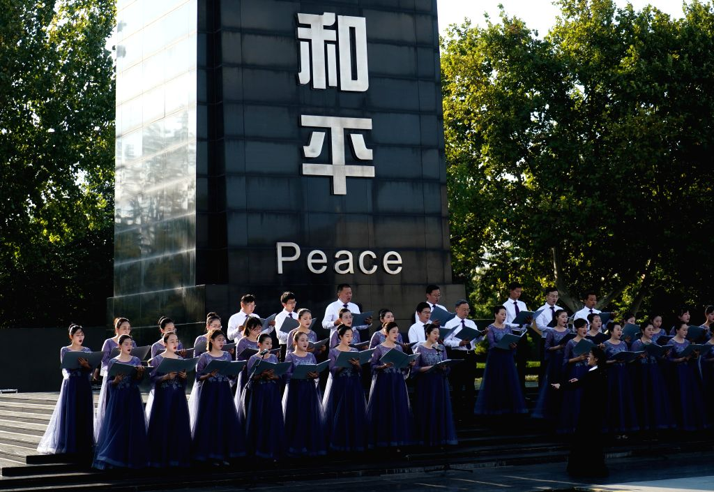 NANJING, Sept. 21, 2019 - Choir members sing during a commemorative event held at the Memorial Hall of the Victims in Nanjing Massacre by Japanese Invaders on the occasion of the International Day of ...
