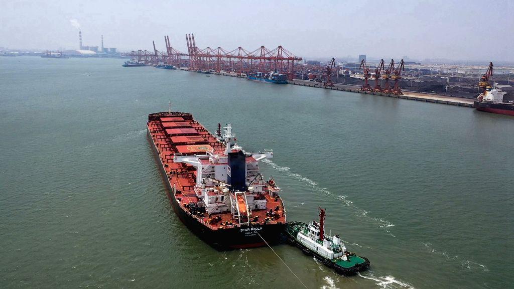 NANNING, Aug. 15, 2019 - Photo taken on May 22, 2019 shows a cargo ship preparing to dock at the Qinzhou Bonded Port Area in Qinzhou, south China's Guangxi Zhuang Autonomous Region. China has ...