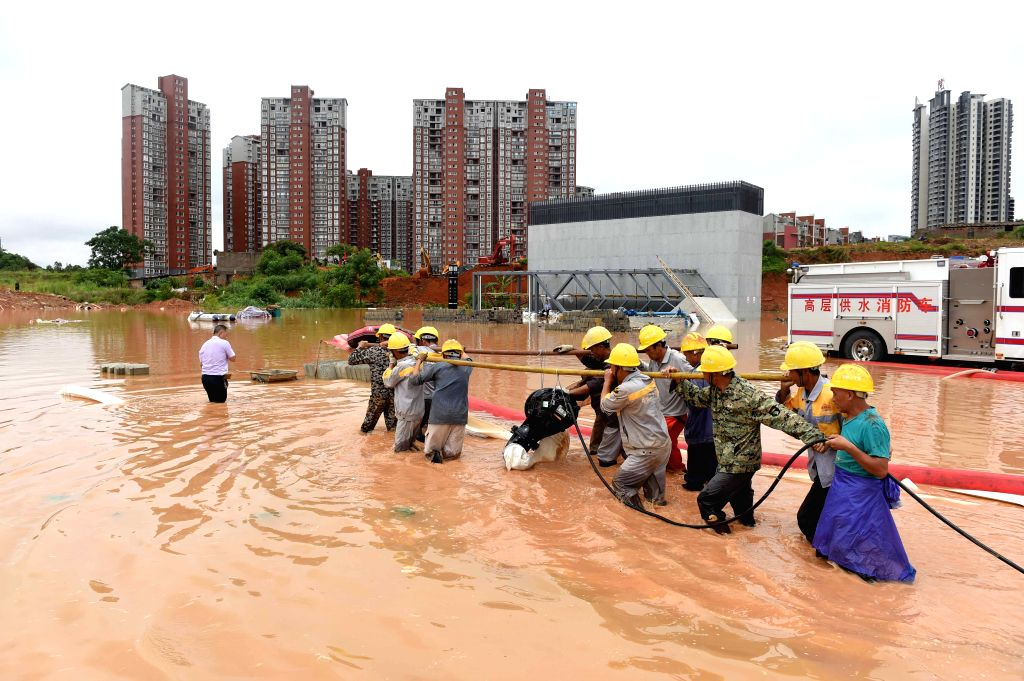 NANNING, June 4, 2016 - Workers transport pumping equipment at flooded Baihualing station on Nanning subway Line 1 in Nanning, capital of south China's Guangxi Zhuang Autonomous Region, June 4, 2016. ...