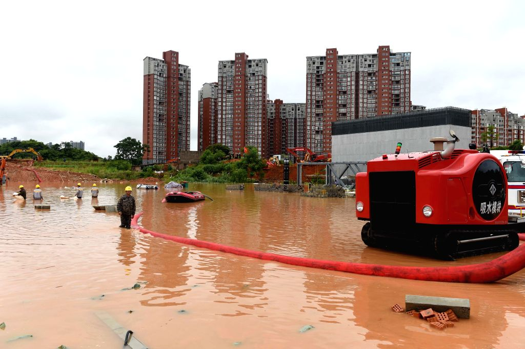 NANNING, June 4, 2016 - Workers use pumping equipment to drain water at flooded Baihualing station on Nanning subway Line 1 in Nanning, capital of south China's Guangxi Zhuang Autonomous Region, June ...